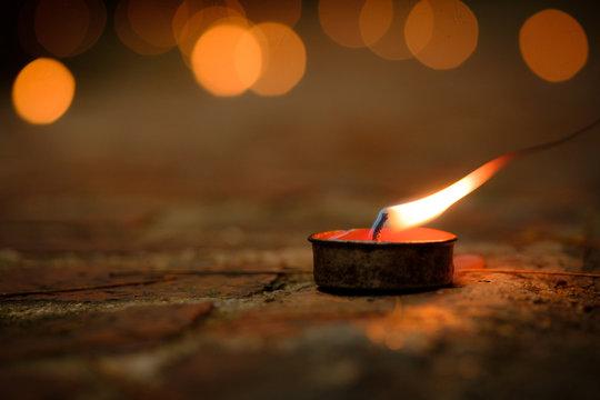 Prayer and hope concept.Retro candle light and retro road .