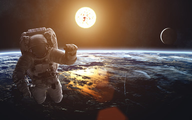 Earth's cosmic landscape. Solar System. Astronaut. Image in 5K resolution for desktop wallpaper. Elements of the image are furnished by NASA