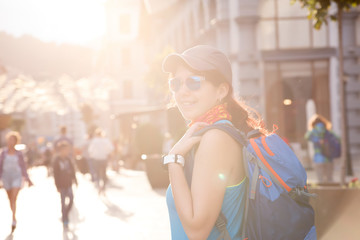 Image of smiling woman with backpack