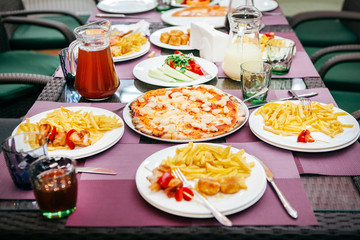 pizza, compote, salad and potatoes for lunch for children