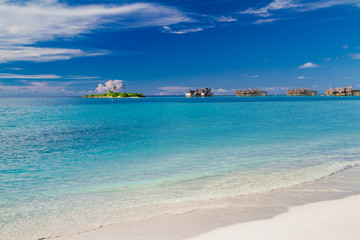 Luxury water villas in Maldives island. Clear blue sea and white sand. Luxurious summer vacation and holiday concept