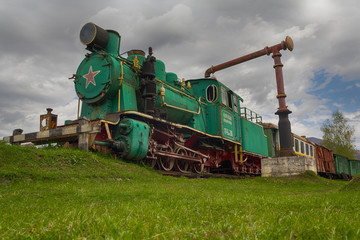 Old Soviet locomotive stands on a dead-end path. Transport