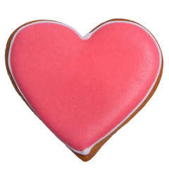 Red gingerbread as heart with colored glaze on isolated closeup