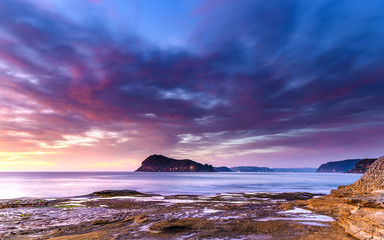 Dawn Seascape with Island and Soft Clouds