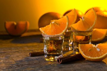 Gold tequila with orange and cinnamon .