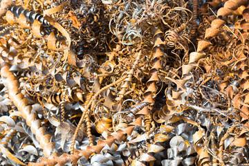 silver spirals of metal shavings as garbage, texture of different size of metal spirals shavings texture, metal shavings texture