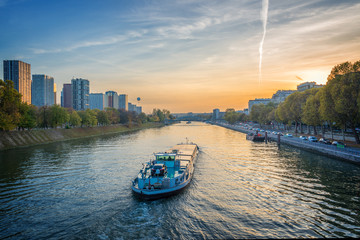 Barge on the river Seine at sunset, Paris France Wall mural