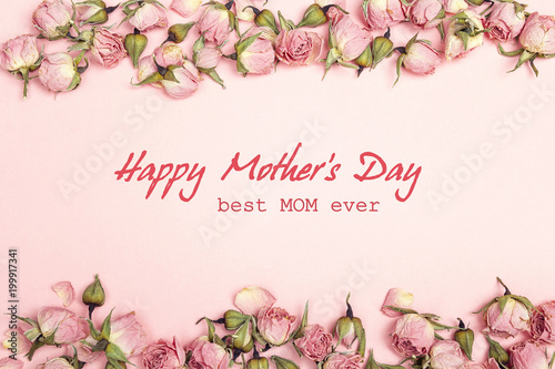 Mothers day greeting message with small dry roses on pink background mothers day greeting message with small dry roses on pink background flat lay top m4hsunfo