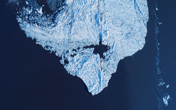 Melting ice cap from above, drone photography, global warming concept