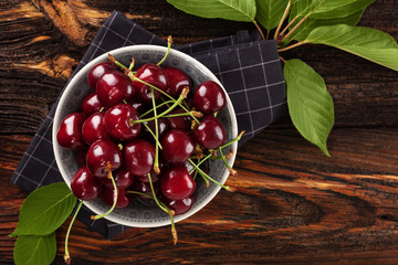 Delicious cherries in bowl from above.