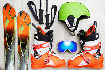 Photo of skier objects on wooden background.