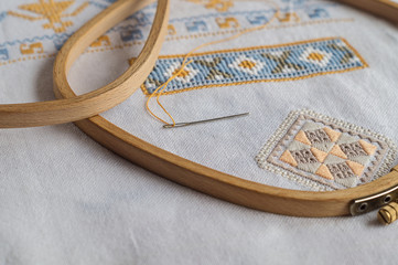 Fragment of hand embroidery by different techniques