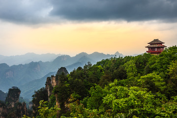Pagoda on the hill with mountains in the background and forest in the foreground,  Zhangjiajie national park, Hunan province, China