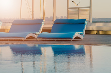 chaise lounge near the pool. concept of a healthy lifestyle