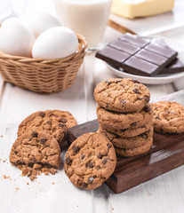 cookies and their ingredients on a white wooden table