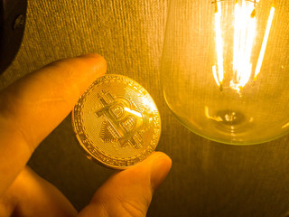 Bitcoin with coins on computer board and copy space using as background technology, money finance, business concept.