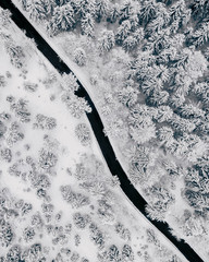 Aerial view of road passing through snowy landscape