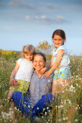 Portrait of   grandmother and two granddaughters