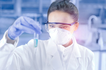 Female scientist looking at the scientific sample in the CDC laboratory