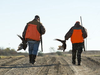 Grandfather and Grandson out Pheasant hunting