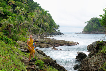 Tourist returning from diving on wild coast of the Caribbean sea. Colombia