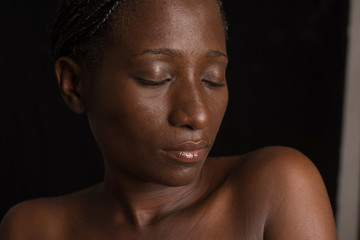 close up of woman's face in the darkness