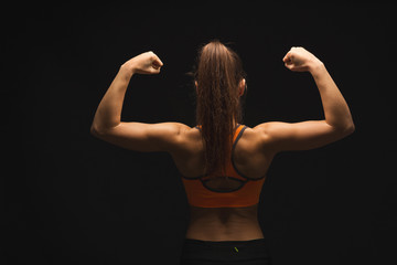 Athletic woman showing muscular body