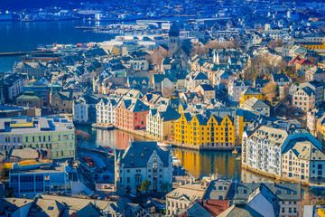 Beautiful outdoor view of colorful buildings from the mountain Aksla at the city of Alesund, Norway