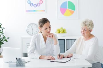 Senior woman filling medical information