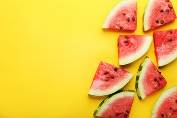 Slices of watermelons on yellow background