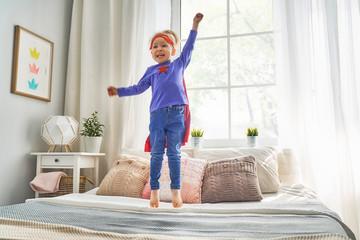 child is playing superhero
