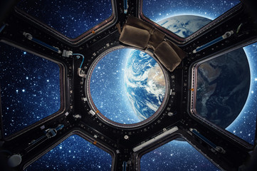 Wall Mural - Earth and galaxy in spaceship international space station window porthole. Elements of this image furnished by NASA