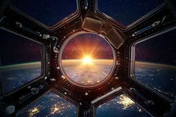 Earth and galaxy in spaceship international space station window porthole. Elements of this image furnished by NASA Wall mural