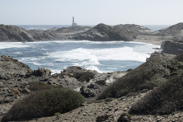 Lighthouse on the slate cape of Favaritx, Menorca, Balearic Islands, Spain