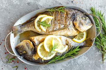 Photo sur cadre textile Poisson Baked fish dorado. Sea bream or dorada fish grilled