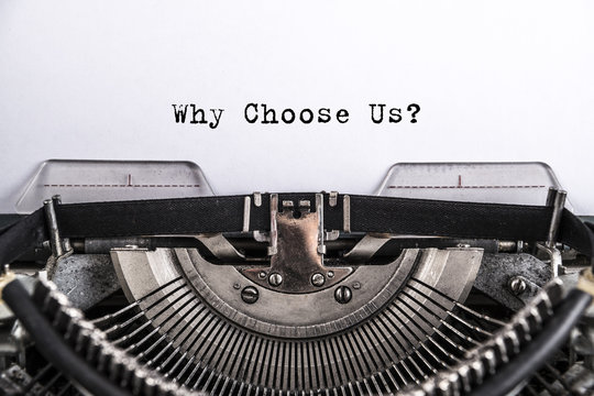 Why Choose Us? the text is typed on an old vintage typewriter with white paper. Business idea