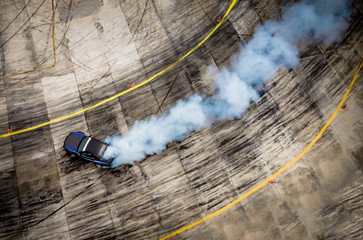 Top view of aerial from drone. Professional driver drift car on asphalt track.Motor sports concept.