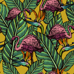 Seamless pattern of pink flamingos and exotic flowers. Strelitzia and tropical birds. Summer.