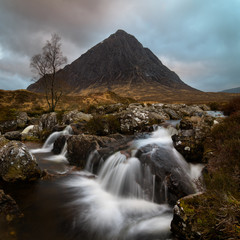 The beautiful waterfall with in the background the Buachaille in Glencoe area Scotland