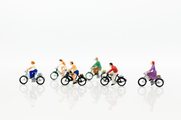Miniature people: People use bicycles as vehicles to travel. Image use for energy reduction and exercise in everyday.