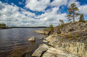 Wall Mural - Nature of Russia. Karelia. Rocky coast of the island. Pine trees grow on a stony shore. Nature of Karelia. The shore of Lake Ladoga. The reserved places of Russia. The nature reserve.