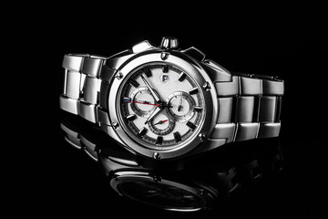 Luxury watch isolated on a black background with reflection. High quality. Highclass.