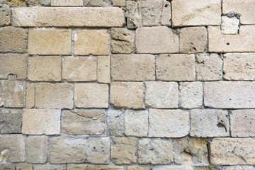 Old stone wall closeup from an ancient medieval castle in Kyrenia, North Cyprus