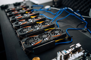 Gpu cards preparing to mine cryptocurrency, devices on mining rig. bitcoin. Fototapete