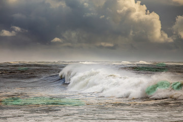 Stormy ocean with big waves and dark clouds
