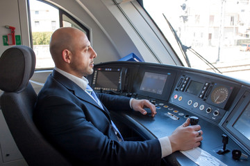 Train driver in cabin