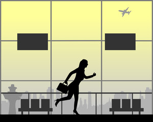 Woman runs at the airport because he is late on the flight, one in the series of similar images silhouette