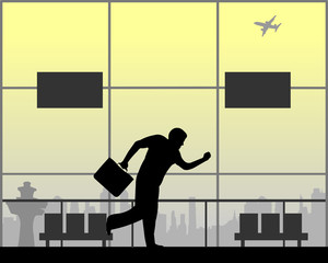 Man runs at the airport because he is late on the flight, one in the series of similar images silhouette