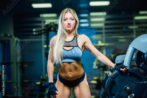 5e670d10e6 Muscular sexy fitness woman woman relaxing in the gym. Concept of healthy  lifestyle. Bodybuilder in the gym