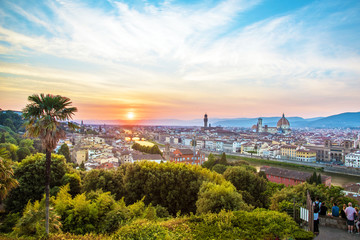 incredibly beautiful magic panoramic view of Florence from Michelangelo Square at sunset. It is a pilgrimage of tourists and romantics. Duomo Cathedral. Italy, Tuscany